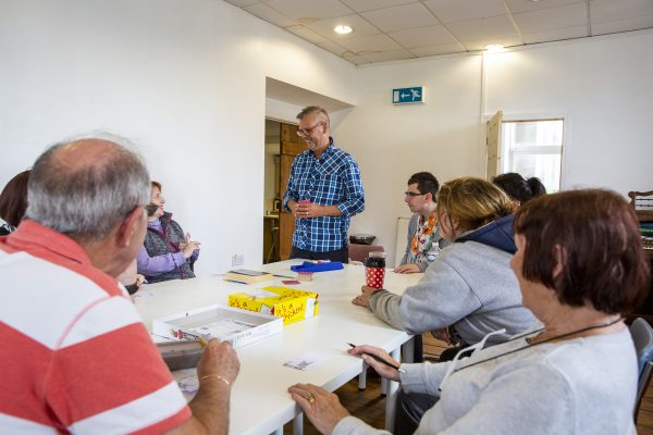 Afternoon board games and artwork session at Maundy Relief Trust, Accrington, Lancashire. (Photo by Andy Aitchison)